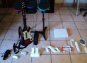 Vendo wii medio uso no tiene ni el ano de uso,se vende junto con rock band y accesorios