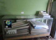 Inicia tu negocio se vende exividor vitrina , 2 anaqueles  y caja registradora