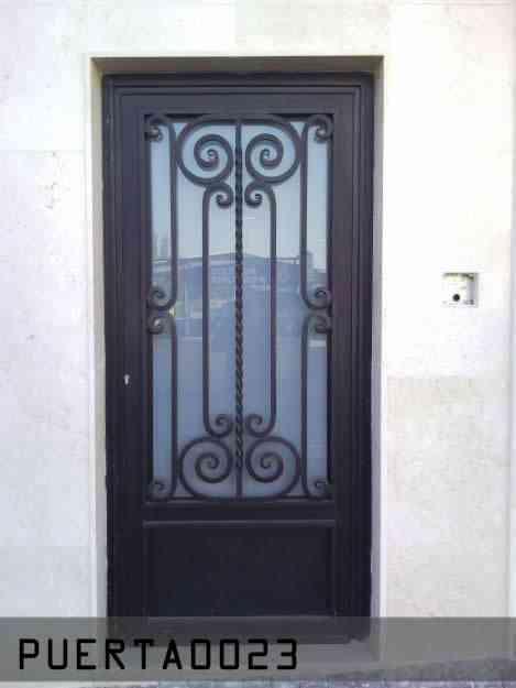 Puertas de herreria artistica puebla otros servicios for Modelos de puertas de hierro con vidrio